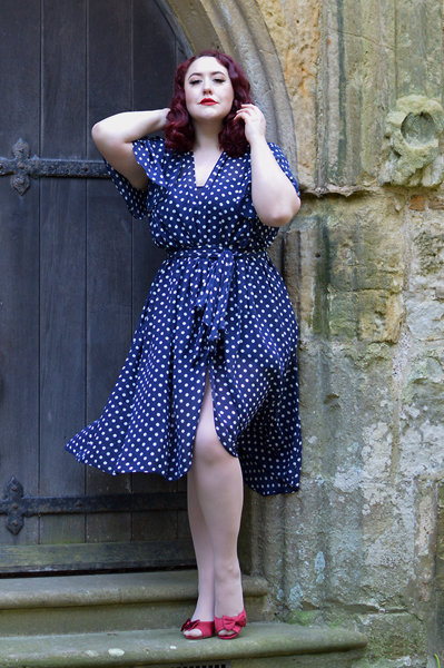 plus sized pinup fit review by Miss Amy May of the Navy Polka Dot Flutter Sleeve Claudia dress by Alexandra King for Deadly is the Female