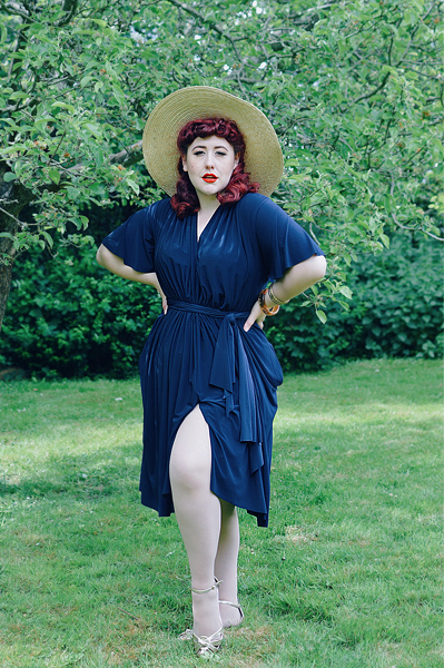 Plus size pinup Miss Amy May reviews the Navy Flutter Sleeve Claudia dress by Alexandra King for Deadly is the Female, including fit and size details
