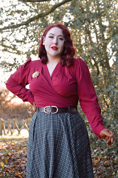 Plus size pinup Miss Amy May models the Rock'n'Romance Darla Wrap blouse in wine for her fit review