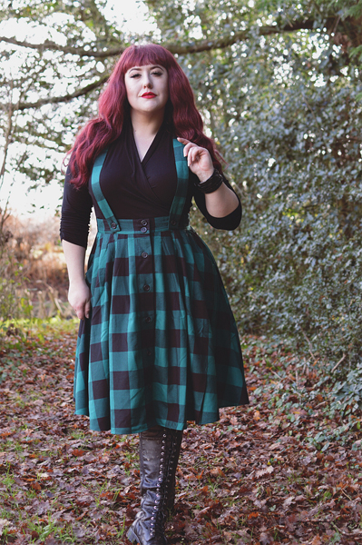 Plus size pinup Miss Amy May models the Green Teen Spirit Pinafore skirt gifted by Hell Bunny for a fit and sizing review