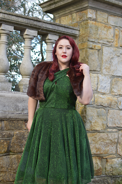 Plus size pinup Miss Amy May modelling the Emerald Metallic Ribbed Valentina swing dress gifted by Unique Vintage for a fit and sizing review