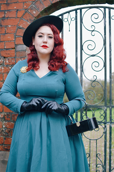 Plus size pinup Miss Amy May models the teal Parinita-Sento dress gifted by Miss Candyfloss for a fit and size review
