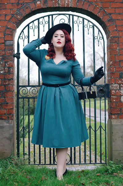 Plus size pinup Miss Amy May models the teal Parinita-Sento dressgifted byMiss Candyfloss for a fit and size review