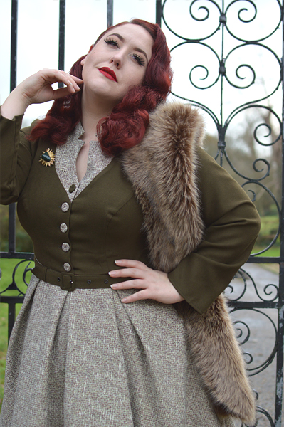 Plus size pinup Miss Amy May models the Tamrika-Sand dress gifted by Miss Candyfloss for a fit and size review