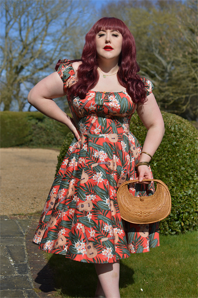 Plus size pinup Miss Amy May models the Ukulele 50s dress gifted by Hell Bunny for a fit and size review