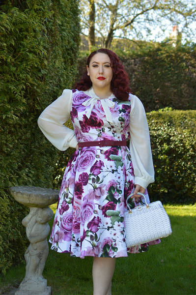 Plus size pinup Miss Amy May models the Alice Floral Swing dress gifted by Hearts and Roses London for a fit and size review