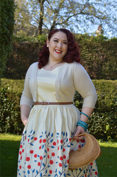 Plus size pinup Miss Amy May modelling the Candice Danube floral swing dress gifted by Collectif Clothing for a fit and size review