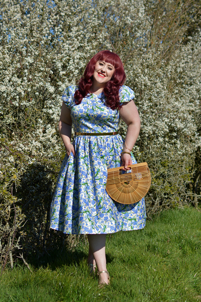 Plus size pinup Miss Amy May models the Collectif clothing Demira Dreamy Floral dress for a fit and size review