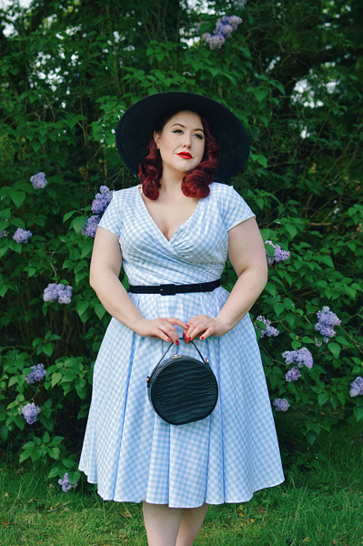 Plus size pinup Miss Amy May models the Hourglass White and Blue Gingham cotton Swing dress by The Pretty Dress Company for a fit and size review