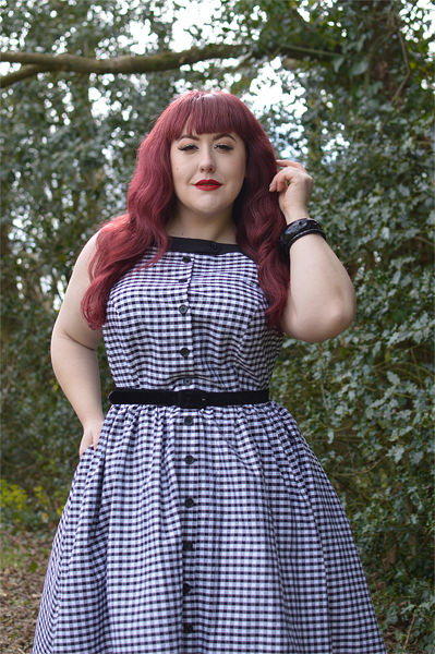 Plus size pinup Miss Amy May models the Black gingham Maxine dress by Unique Vintage for a fit and sizing review