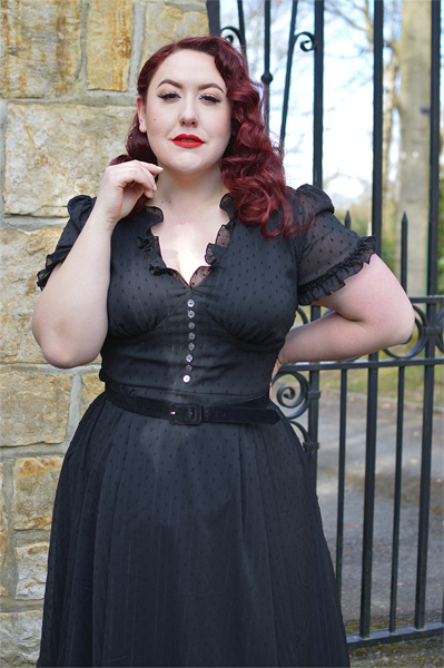 Plus size pinup Miss Amy May models the black Frilly Sundae dress gifted by Hell Bunny for a fit and size review