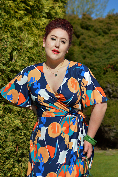 Plus size pinup Miss Amy May models the Abstract Print Midi Wrap Day Dress by Chi Chi London for a fit and sizing review
