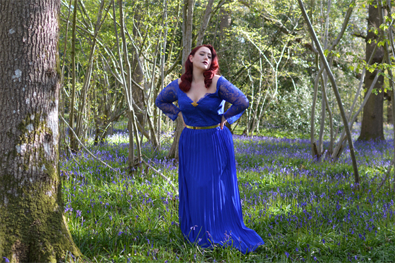 Plus size pinup Miss Amy May models the Blue Lace Sleeve Maxi Bridesmaid dress gifted by Chi Chi London for a fit and size review