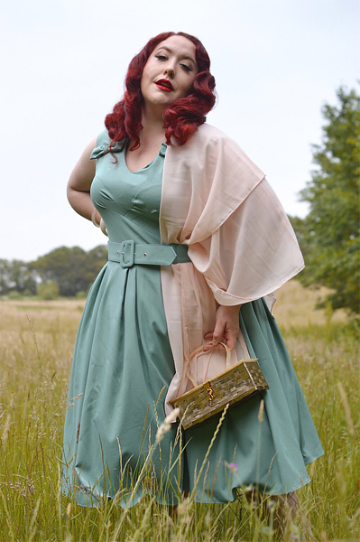 Plus size pinup Miss Amy May models the Korinna-Minty dress gifted by Miss Candyfloss for a fit and size review