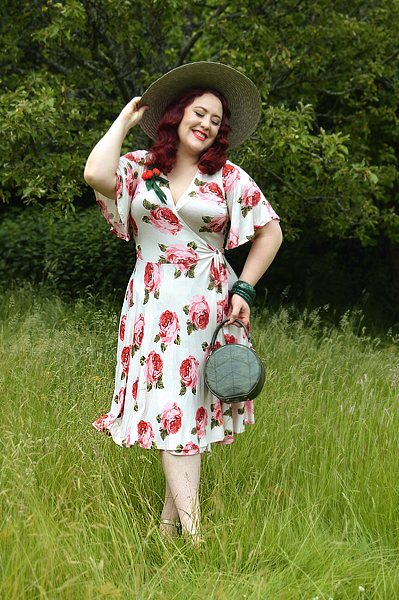 Plus size pinup Miss Amy May models the Rose Cream Aurora Dress gifted by Wax Poetic Clothing for a fit and size review