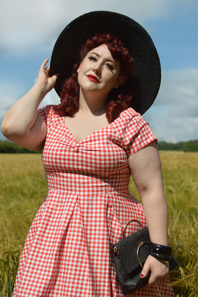 Plus size pinup Miss Amy May models the Red gingham off the shoulder Lily dress by Dolly & Dotty for a fit and size review