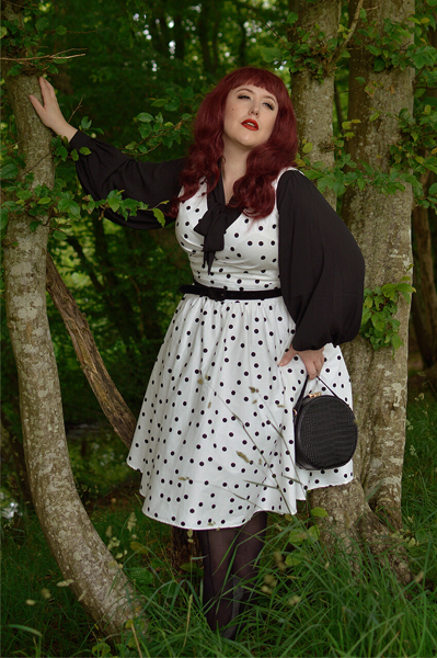 Plus size pinup Miss Amy May models the Polka Dot May crossover bust swing dress gifted by Dolly & Dotty for a fit and size review