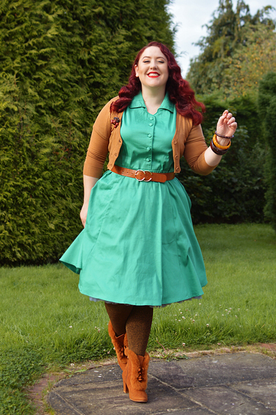 Plus size pinup Miss Amy May models the green Penelope shirt dress gifted by Dolly & Dotty for a fit and size review