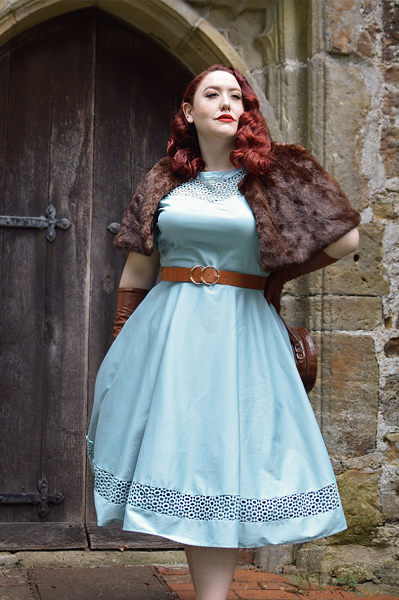 Plus size pinup Miss Amy May models the Baby Blue Tessa Tess dress by Dolly & Dotty for a fit and size review