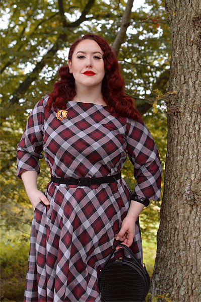 Plus size pinup Miss Amy May models the burgundy and grey plaid Devon swing dress for a fit and sizing review
