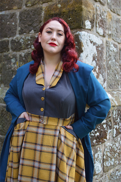 Plus size pinup Miss Amy May models the Isolde-Sun dress by Miss Candyfloss for a fit and size review