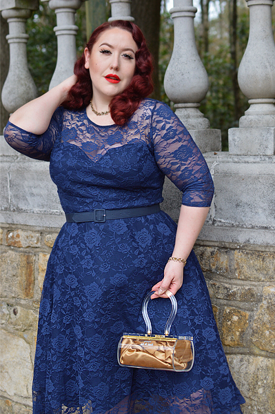 Plus size pinup Miss Amy May models the navy blue Madeline lace dress by Dolly and Dotty for a fit and size review
