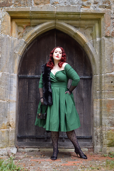 Plus size pinup Miss Amy May models the green Marceline dress by Unique Vintage for a fit and sizing review