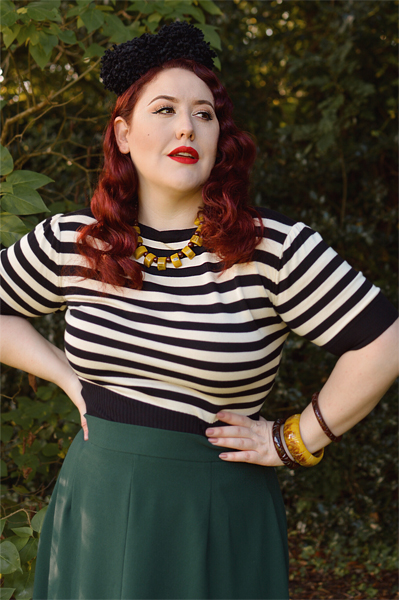 Plus size pinup Miss Amy May models the classic 1940s a-line skirt by Weekend Doll and the black and ivory striped Boatneck sweater by Pretty Retro for a fit and size review